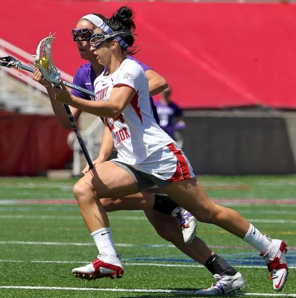 Stony Brook's Janine Hillier drives the net hard