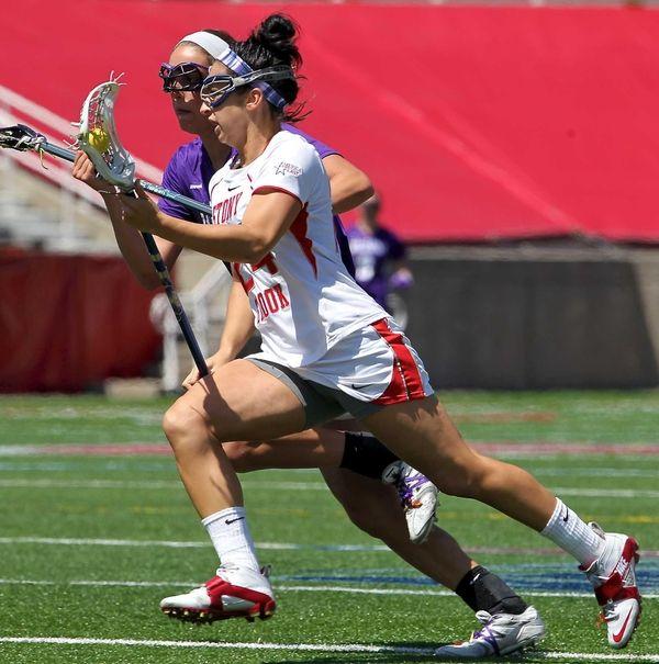 Stony Brook's Janine Hillier drives the net hard