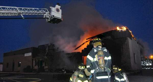 Firefighters battle a blaze just before dawn in