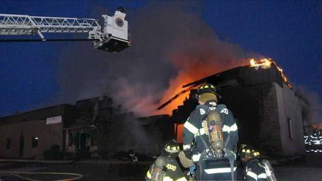 Firefighters battle a blaze just before dawn in