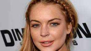 Actress Lindsay Lohan arrives for the premiere of