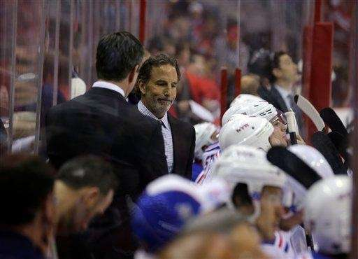 John Tortorella, right, stands in the bench area