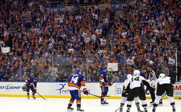 Fans cheer before a faceoff in the third