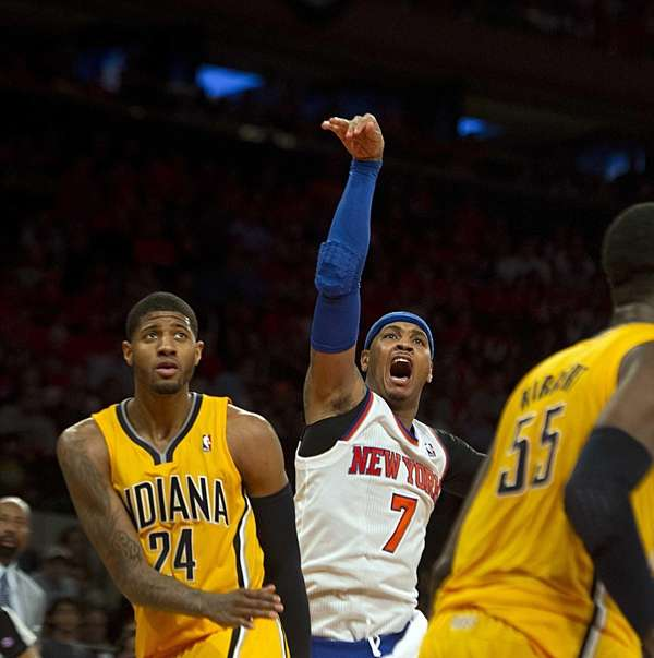 Carmelo Anthony reacts after his shot did not
