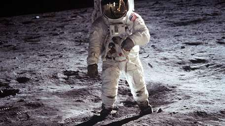 Astronaut Buzz Aldrin, lunar module pilot, walks on