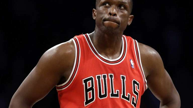 Chicago Bulls forward Luol Deng reacts in the