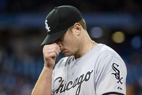 Chicago White Sox pitcher Gavin Floyd reacts after