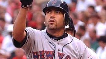 Edgardo Alfonzo reacts after hitting a solo home