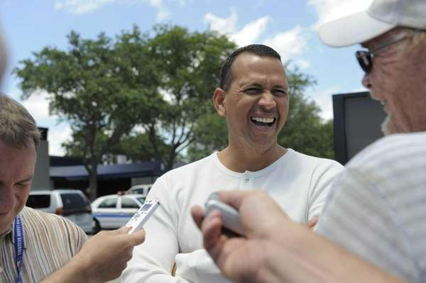 Alex Rodriguez talks to members of the media