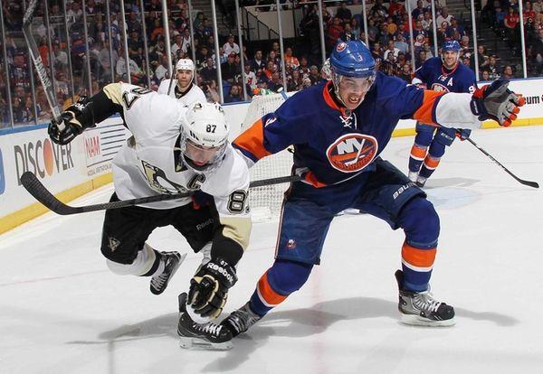 Travis Hamonic gets tangled with Sidney Crosby #87