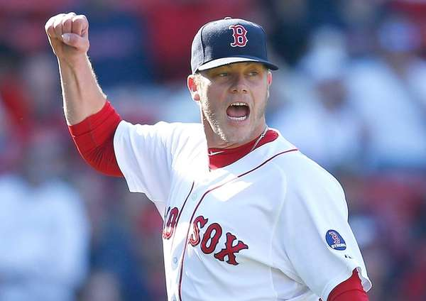 Boston Red Sox pitcher Andrew Bailey reacts after