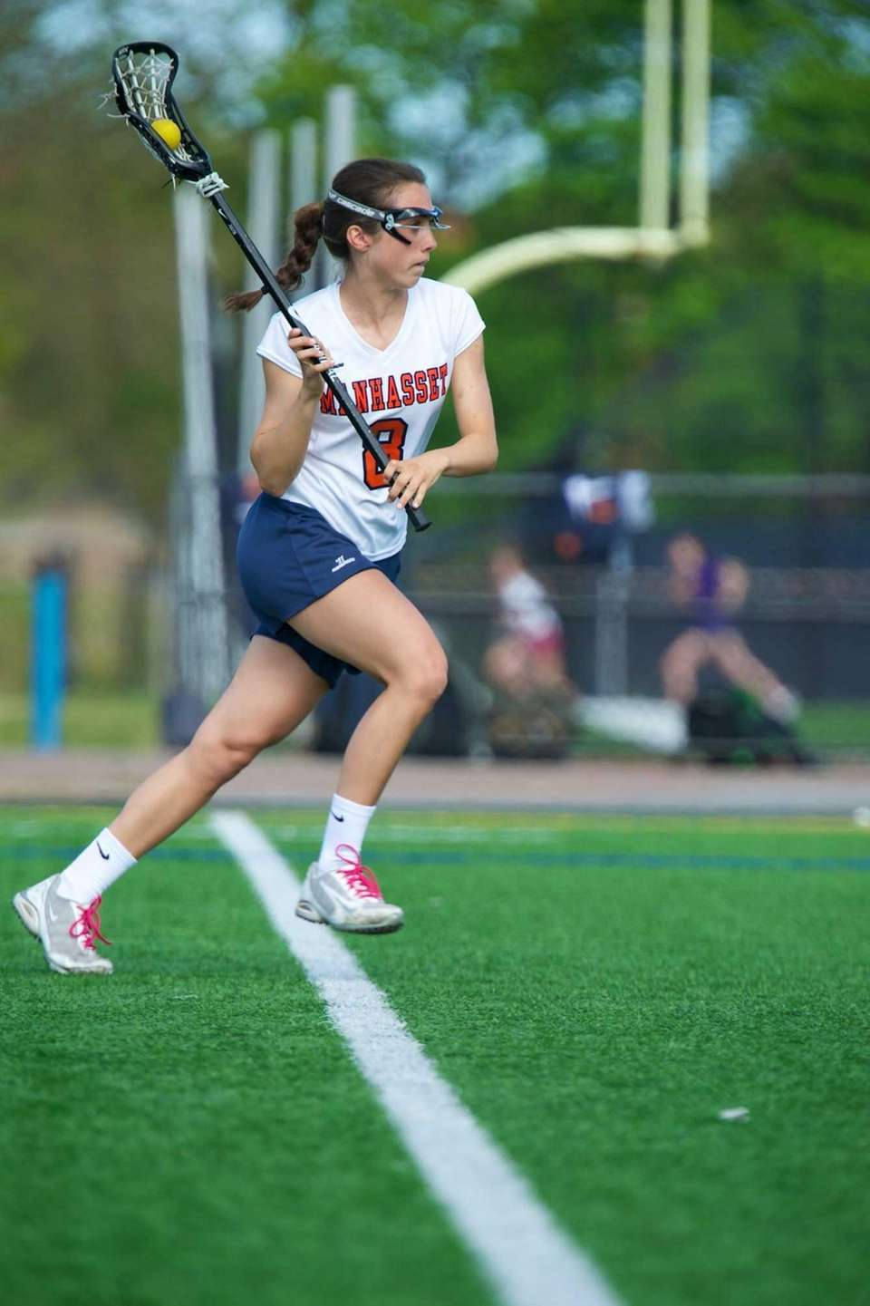 Manhasset junior Julia Glynn (8) carries the ball