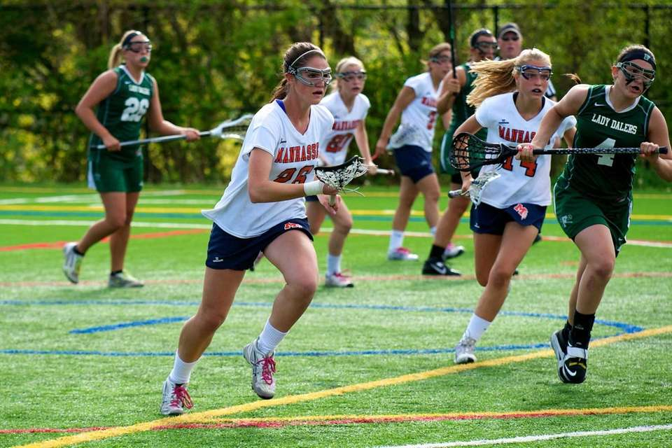 Manhasset midfielder Kellen D'Alleva (26) brings the ball