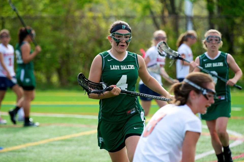 Farmingdale defender Samantha Brescia (4) tightly guards Manhasset