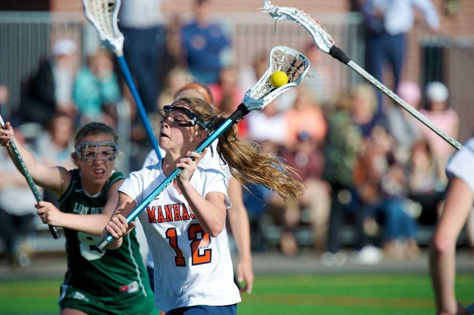 Manhasset attacker Lindsey Ronbeck (13) scores a goal