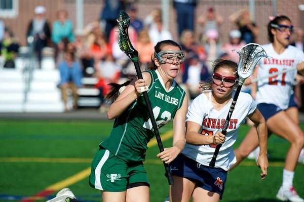 Natalie Stefan had four goals and an assist, and Kellen D'Alleva and Lindsey Ronbeck each had three goals as Manhasset beat Farmingdale in Nasasu Conference I girls lacrosse. (May 6, 2013)