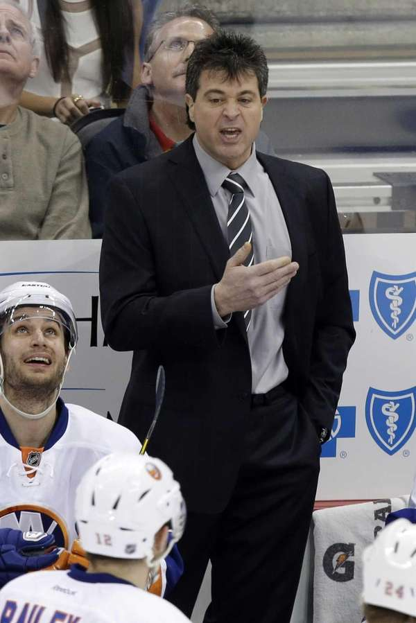 Jack Capuano gives instructions during the third period