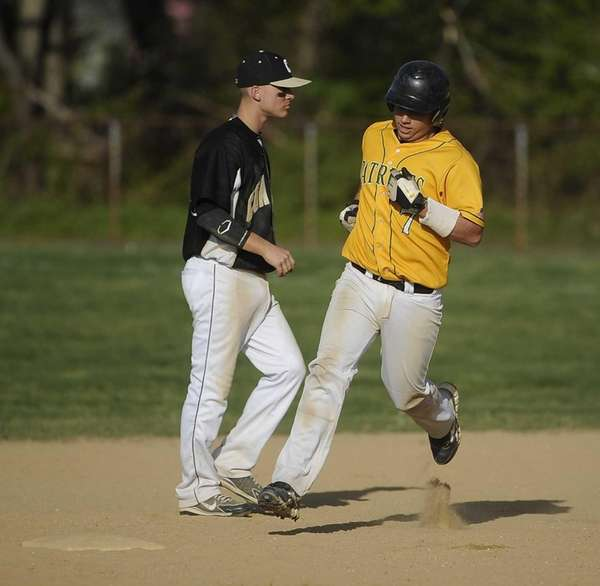Ward Melville's Kyle Pedroli runs the bases after