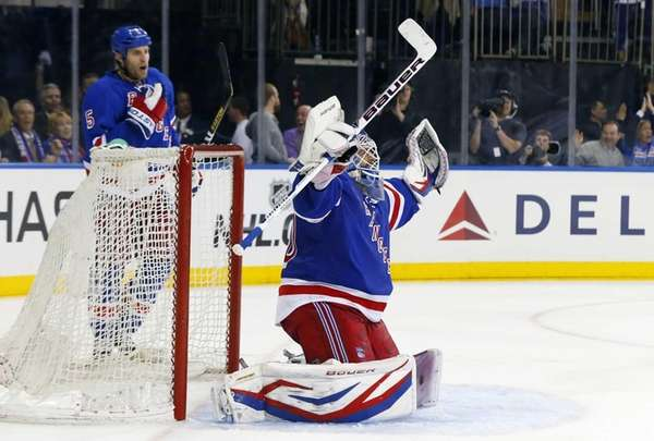 Henrik Lundqvist of the Rangers celebrates after defeating
