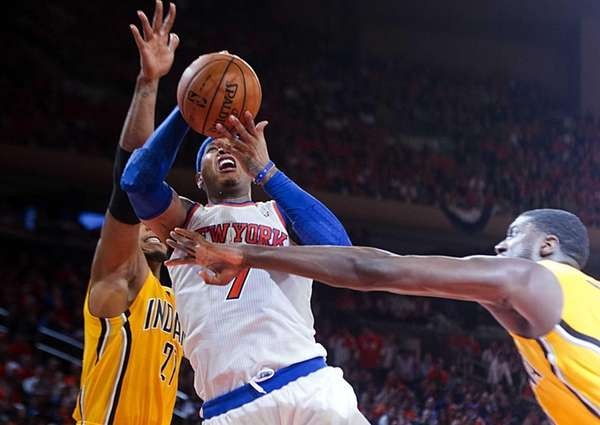 Carmelo Anthony is fouled by the Indiana Pacers'