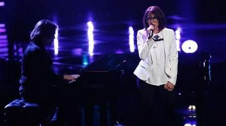 Michelle Chamuel performs during the first round of