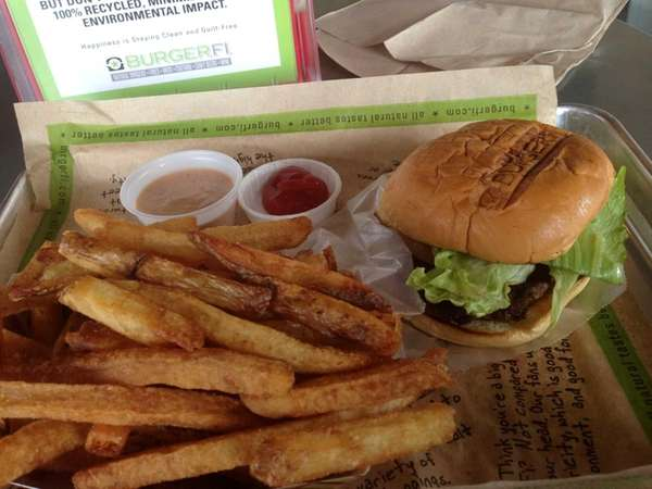 A BurgerFi burger with fries at the new