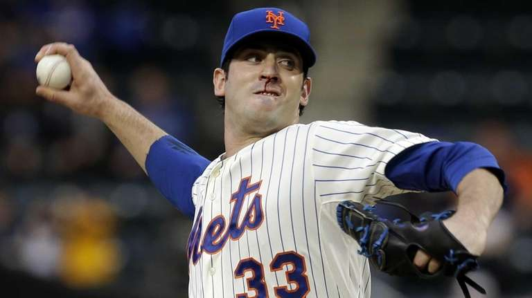 Mets starting pitcher Matt Harvey throws during the