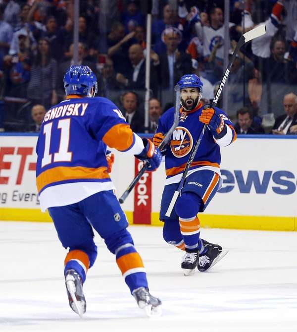 Brian Strait of the Islanders celebrates his first