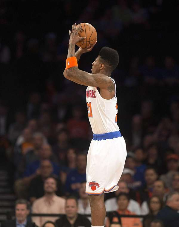 Knicks' Iman Shumpert shoots a jump shot alone