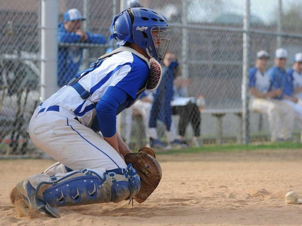 Division catcher Nick Boldi blocks a pitch in
