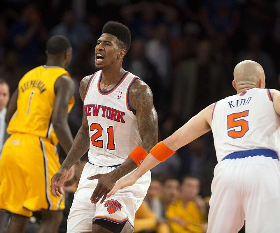 Knicks' Iman Shumpert reacts while getting a hand
