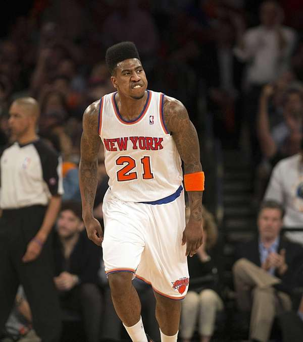 Knicks' Iman Shumpert reacts after hitting a jump
