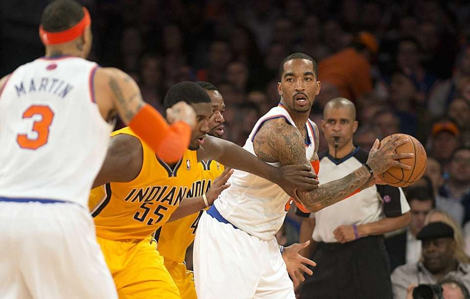 Knicks' J.R. Smith looks to pass the ball