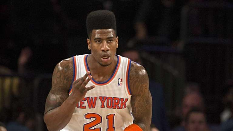 Knicks' Iman Shumpert holds up three fingers after
