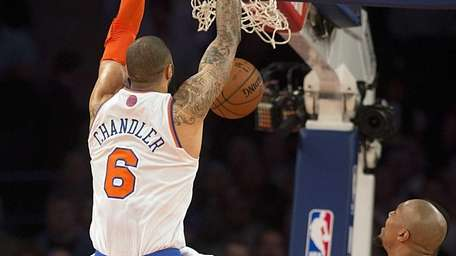 Knicks' Tyson Chandler slams down a dunk while