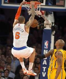 Knicks' Tyson Chandler slams down a dunk while