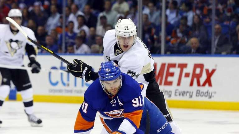 John Tavares of the Islanders is tripped up