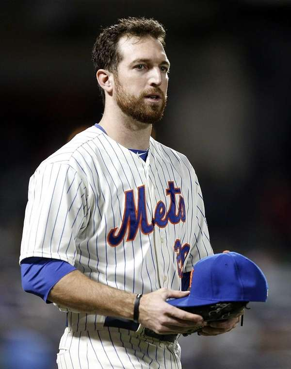 Mets first baseman Ike Davis awaits his glove