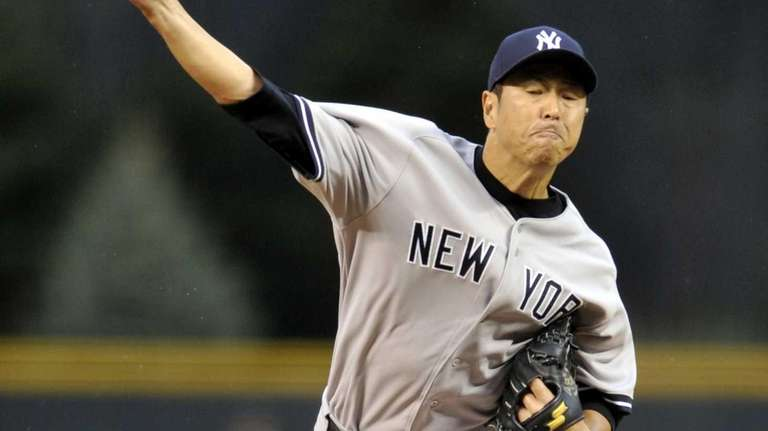 Yankees starting pitcher Hiroki Kuroda throws to the