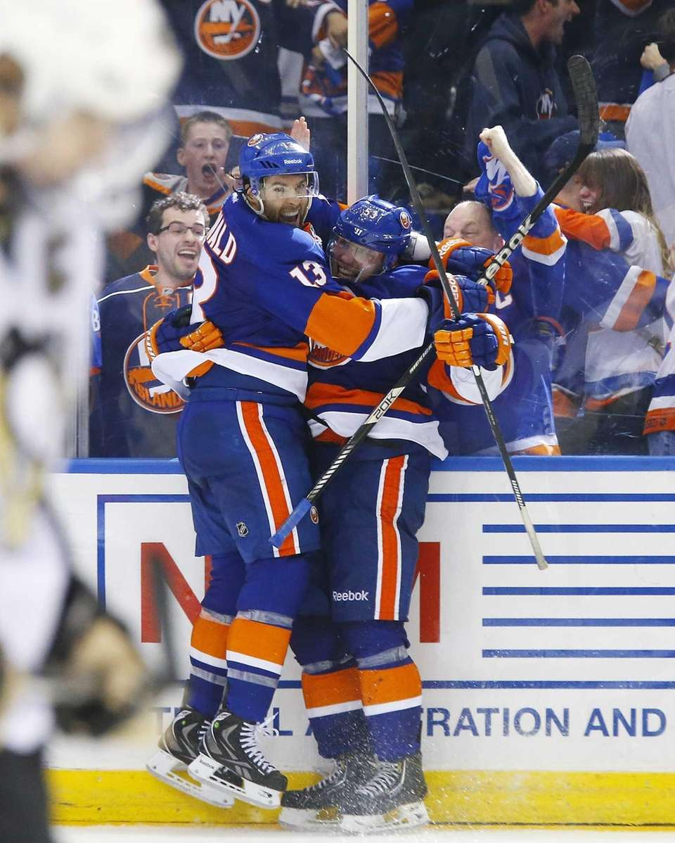 Casey Cizikas of the Islanders celebrates his third