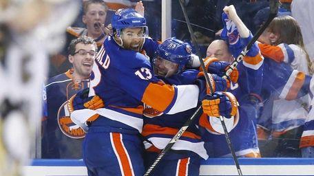Casey Cizikas of the Islanders celebrates his third