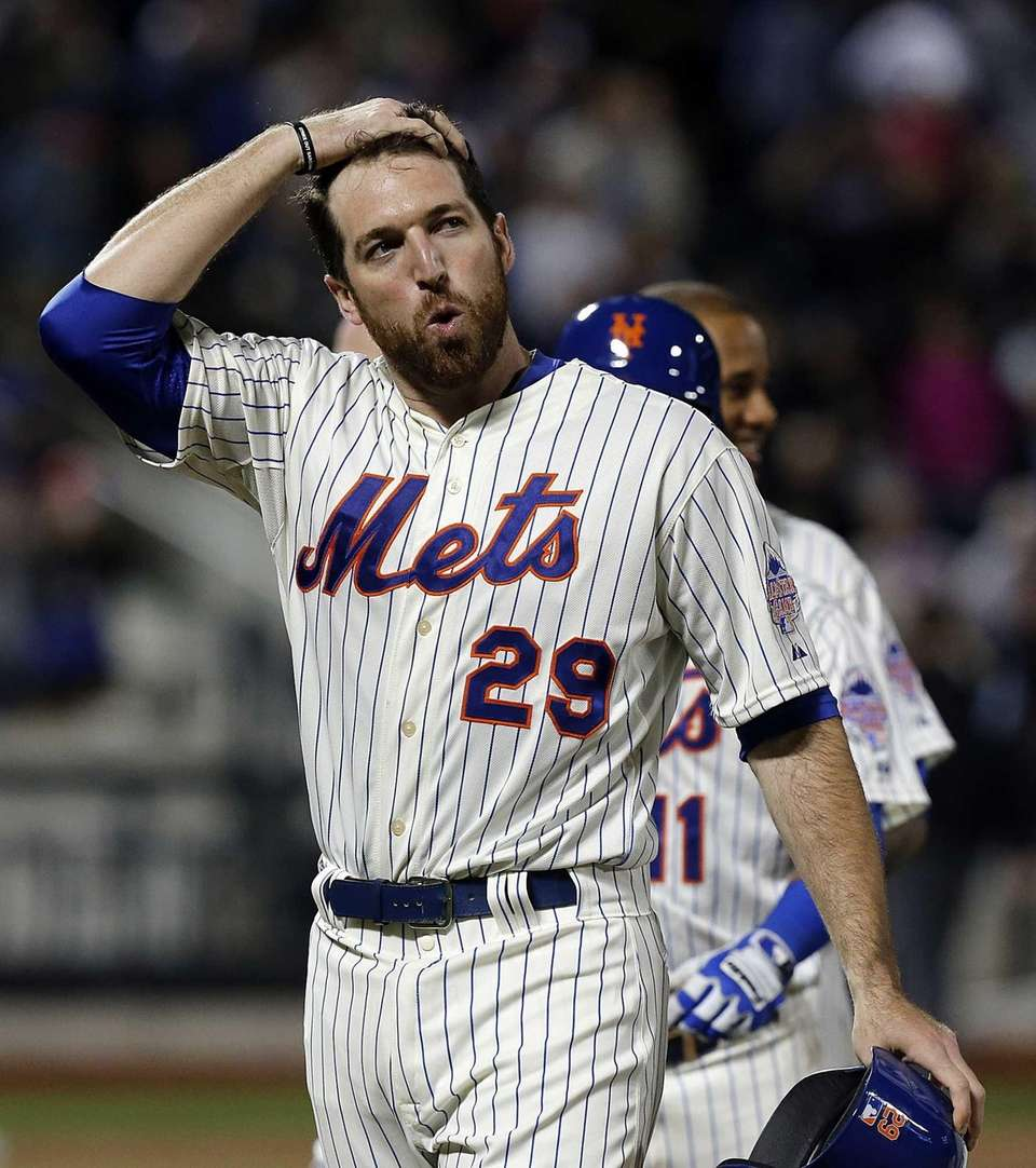 Mets first baseman Ike Davis reacts after scoring