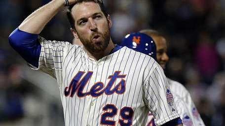 Mets first baseman Ike Davis reacts after scoring