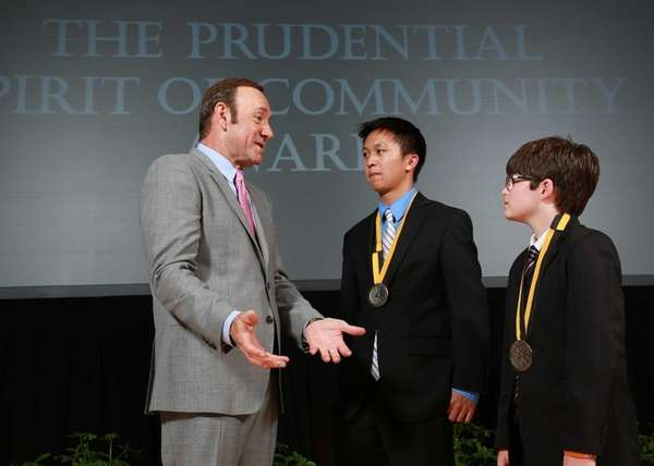 Actor Kevin Spacey congratulates Samuel Lam, 18, of