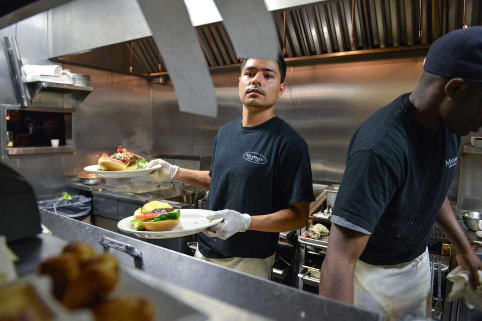 Chef Mario Villalobos works in the kitchen at