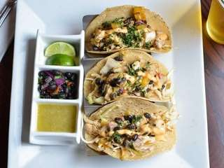 Fish tacos, soft corn tortillas crammed with cubes
