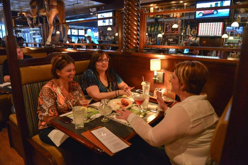 Friends chat over drinks at Maxwell's restaurant in