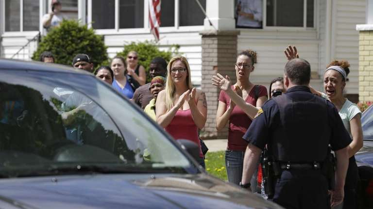 Neighbors and friends of Amanda Berry clap as