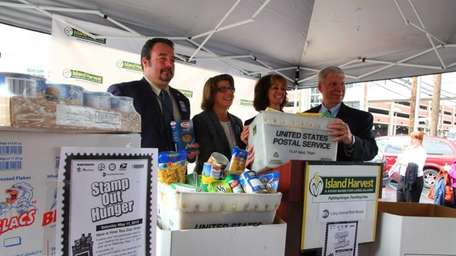 Stamp Out Hunger representatives are, from left, AFL-CIO