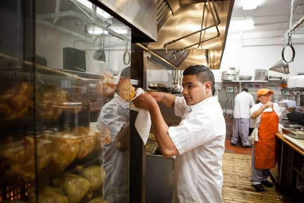 Gerver Guillen mans the rotisserie at Millennium Chicken